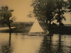 A sailing canoe on a Canadian river